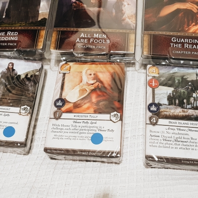 The Red Wedding, All Men Are Fools, and Guarding The Realm expansion packs for the Game of Thrones Card Game Second Edition