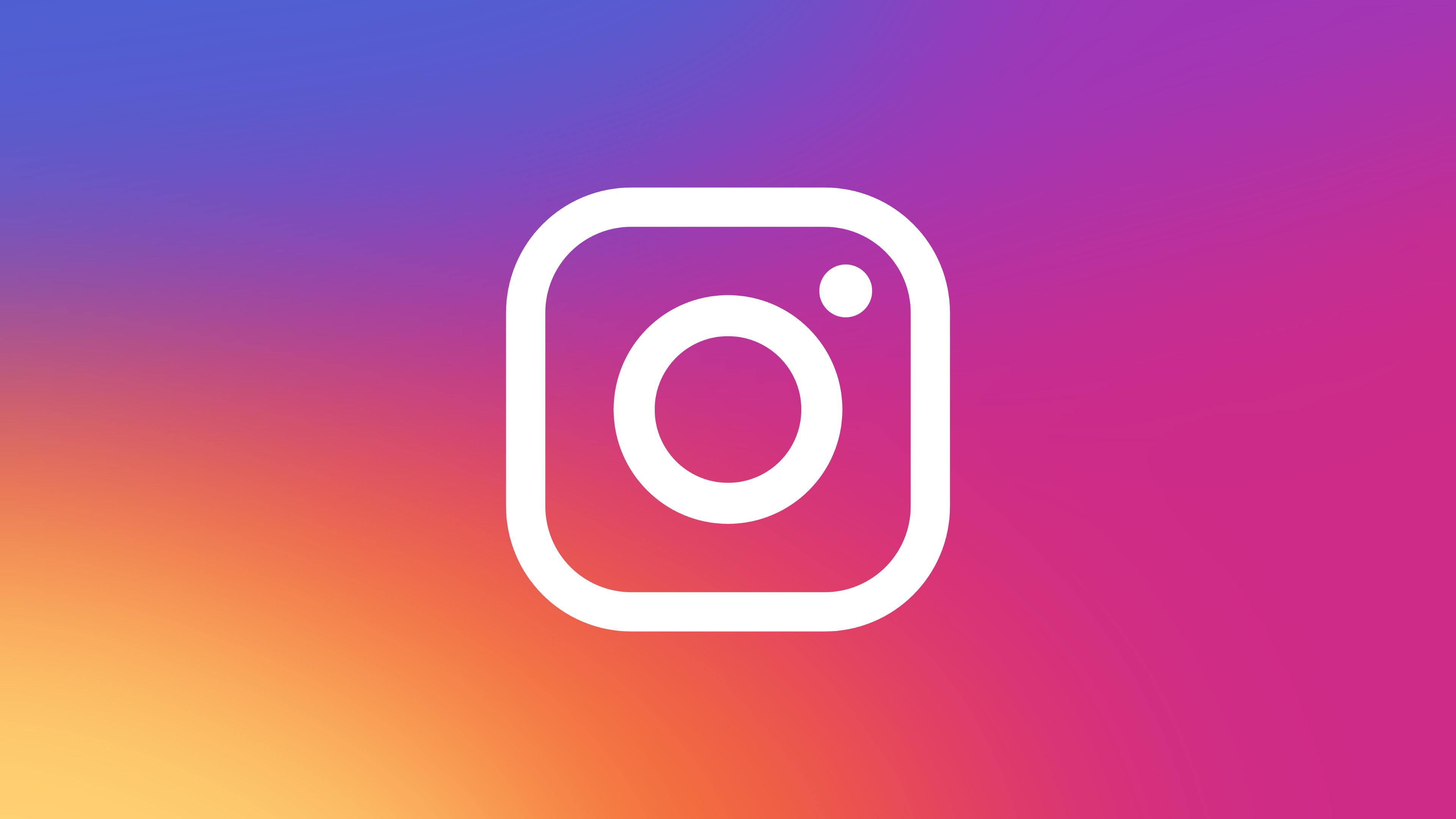 A white Instagram logo (which looks like the outine of a camera) on a colourful gradient background