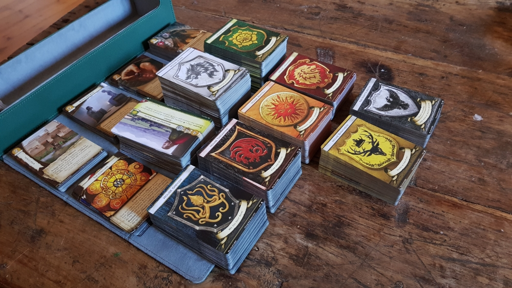 An array of cards from the Game of Thrones The Card Game box sets.