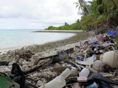 A photo of a beach covered in plastic waste.