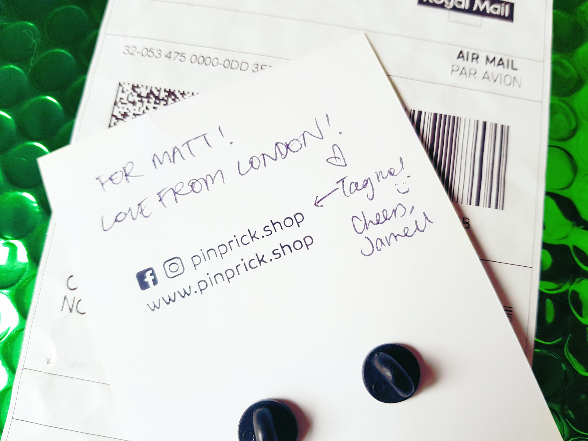 "A photo of a piece of cardboard which reads ""For Matt! Love from London! Cheers, Jarrell"""