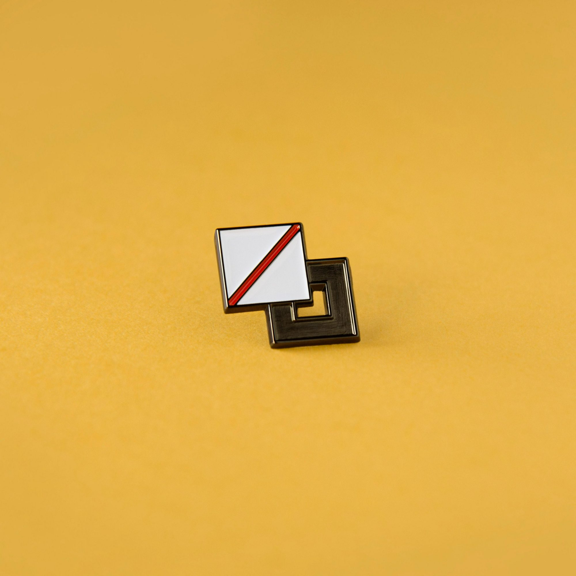A photo of an enamel pin badge that resembles the palette option in design tools