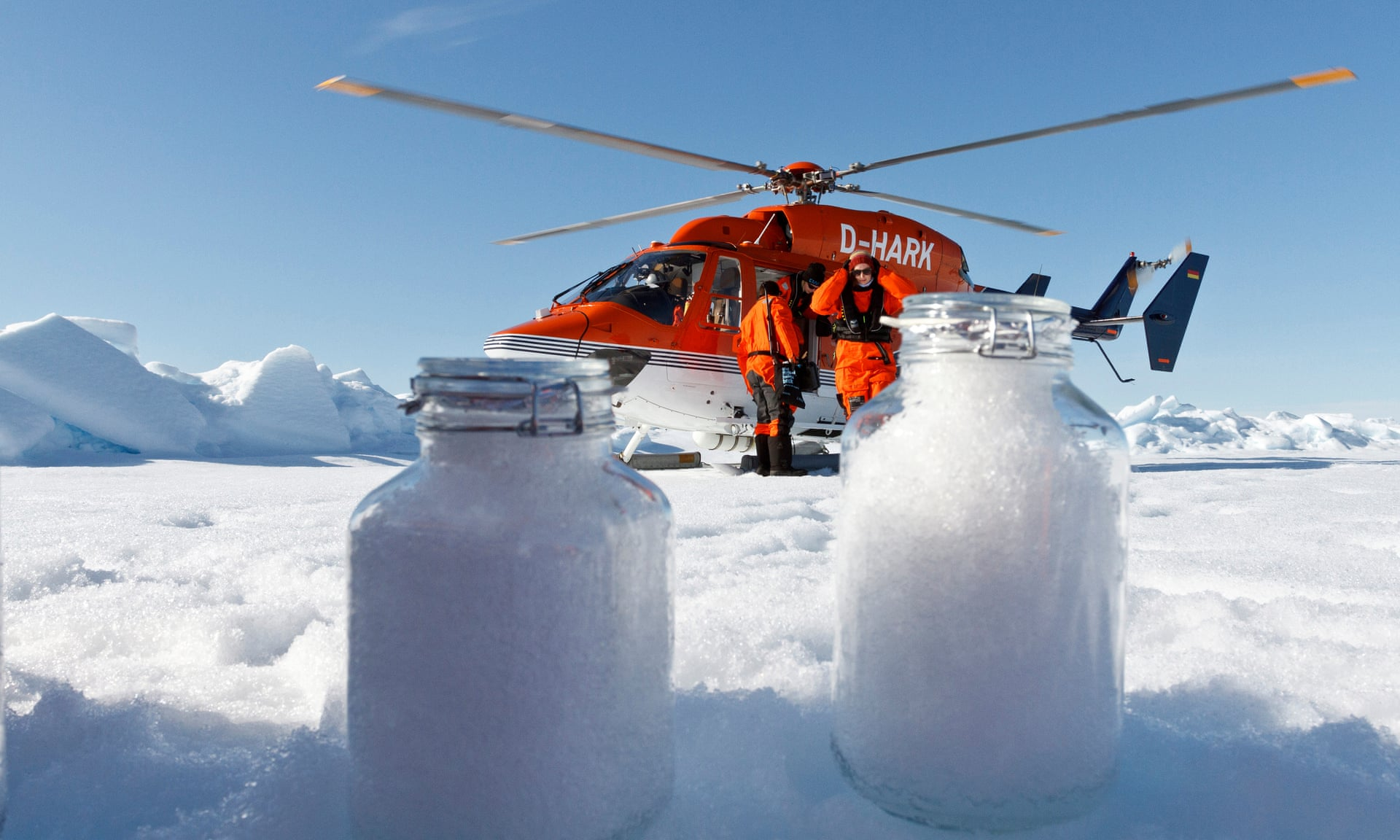 Scientists collect snow samples above the Arctic circle. Photograph: Melanie Bergmann/Alfred-Wegener-Institut/Science Advances