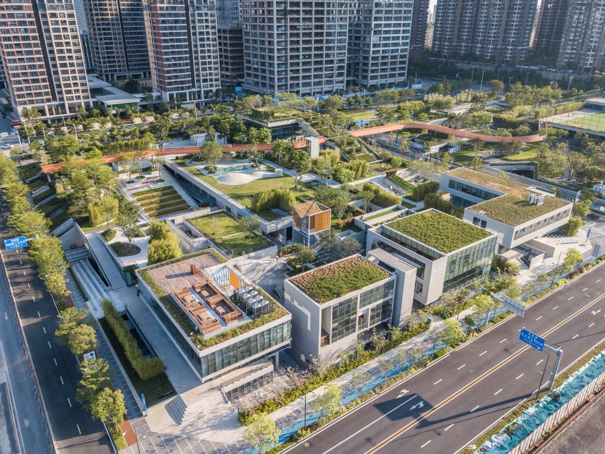 A campus-like park of concrete offices topped with green roofs in Shenzhen