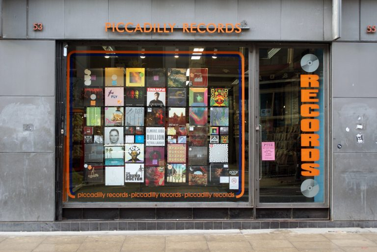 A photo of the outside shop front of Piccadilly Records store in Manchester, UK