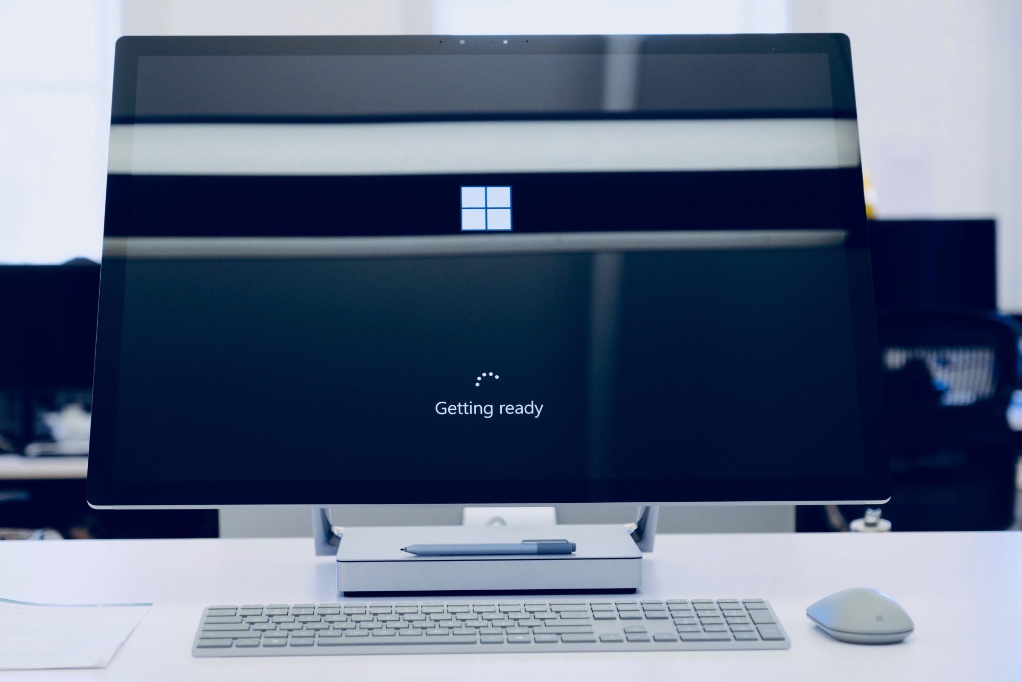 Microsoft Windows loading screen on a large monitor