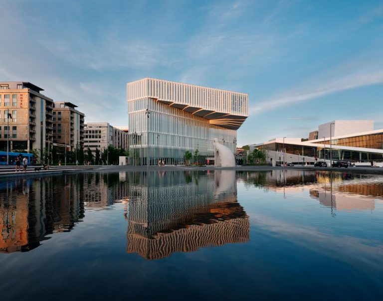A large pool of water outside of Oslo's new central library