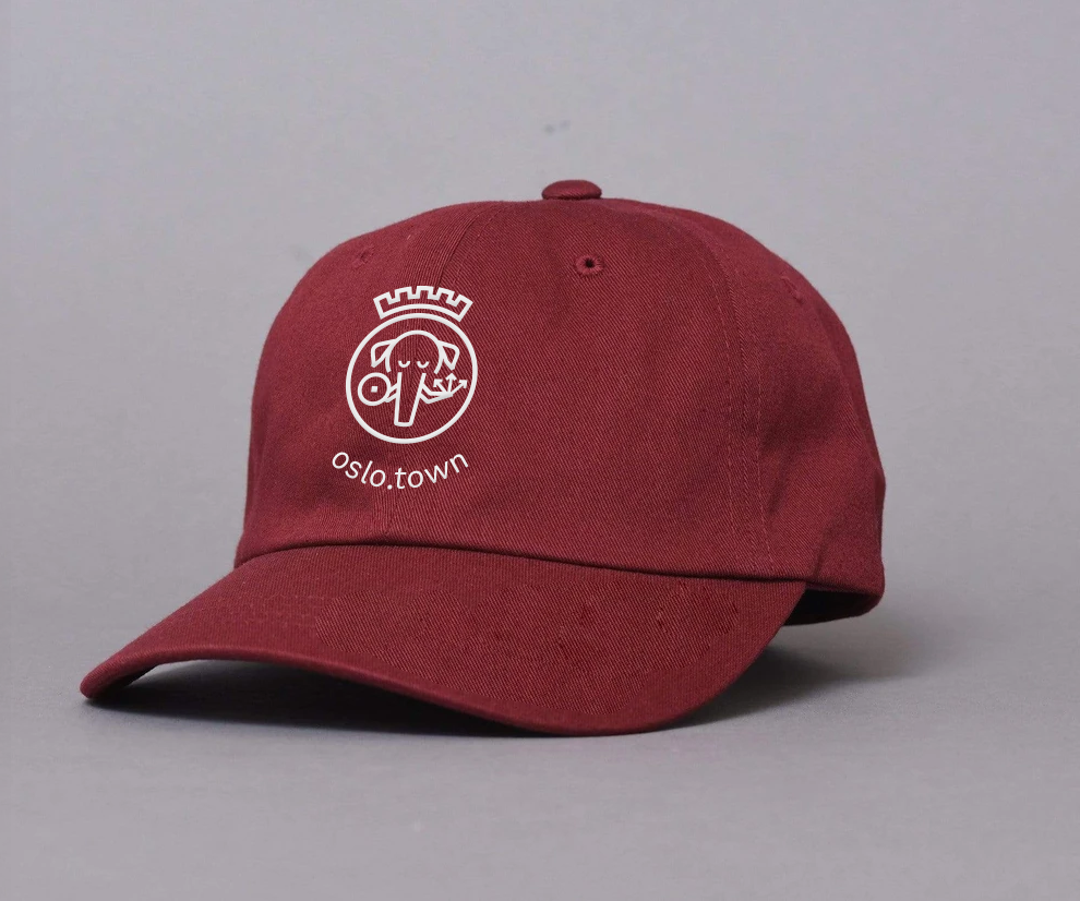 A render of a maroon coloured baseball cap with the Oslo Town logo embroidered on the front